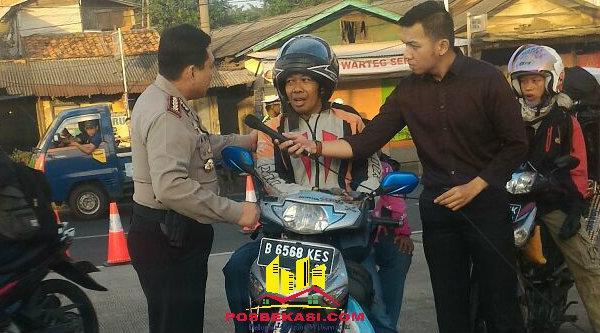 Kapolresta Bekasi Kombes Pol M. Awal Chaiudin mengimbau pemudik sepeda motor untuk tetap menjaga keselamatan di jalan raya.[YAN]