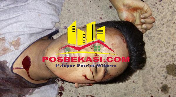 Korban pembunuhan di Jalan Raya Kampung Cabang Empat RT 02/01, Desa Huripjaya, Kecamatan Babelan.[IST]