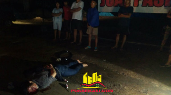 Pelaku pencurian diikat dan dihakimi massa di tengah jalan raya.[BEN]