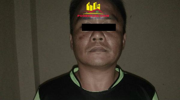 Pelaku rumsong di siang bolong, Irwan Novrizal, diringkus polisi.[OJI]
