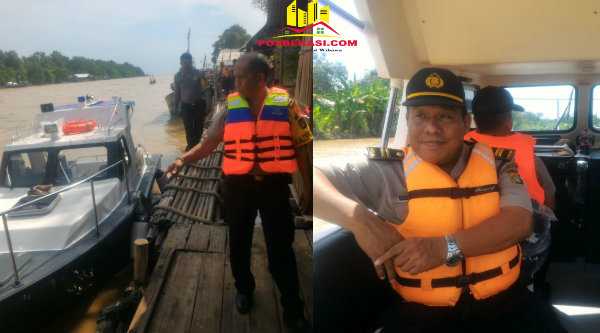 Kapolsek Muara Gembong AKP Sigit Sudarmono saat turun dari kapal patroli di Pantai Bahagia dan Waka Polsek Muara Gembong Iptu Rusbrata bersiaga saat patroli air.[YAN]