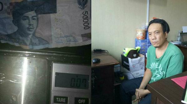Tersangka BS dan barang bukti sabu yang dilipat pada uang Rp50 ribu.[IST